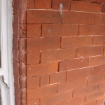 Existing brickwork has previously been repaired incorrectly with sand & cement.