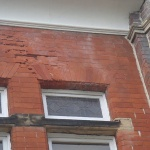 Existing spalled brickwork, to be replaced with matching bricks.